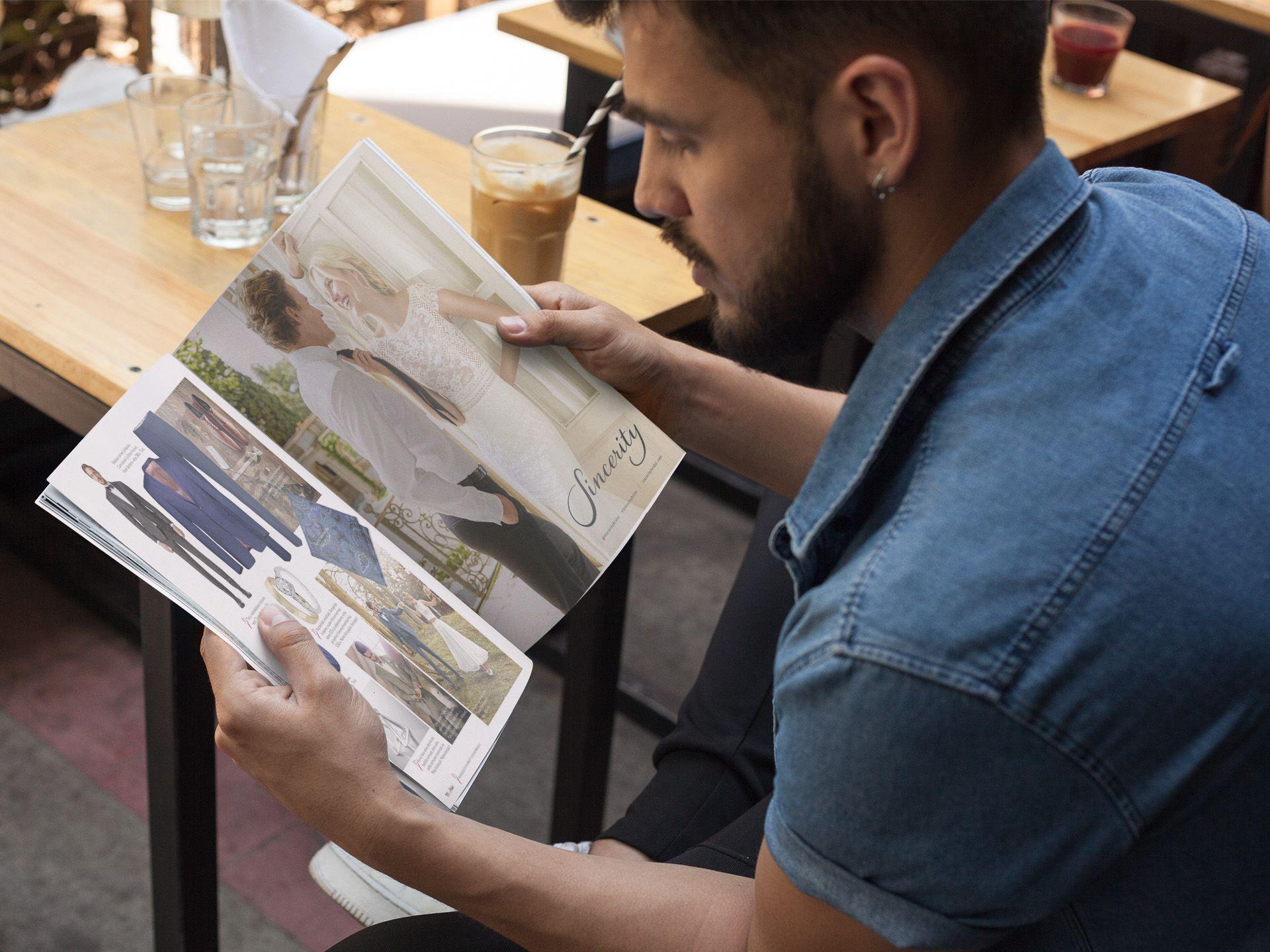Mies tutkii pukuja Häät-lehdessä 1/2019