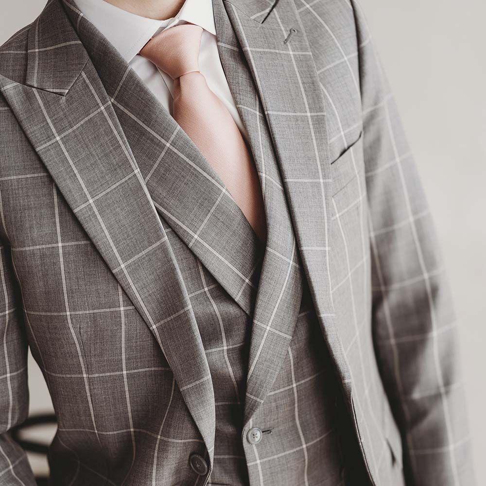 sulhasen puku harmaa ruutupuku mittatilauspuku Räätälistudio BQ